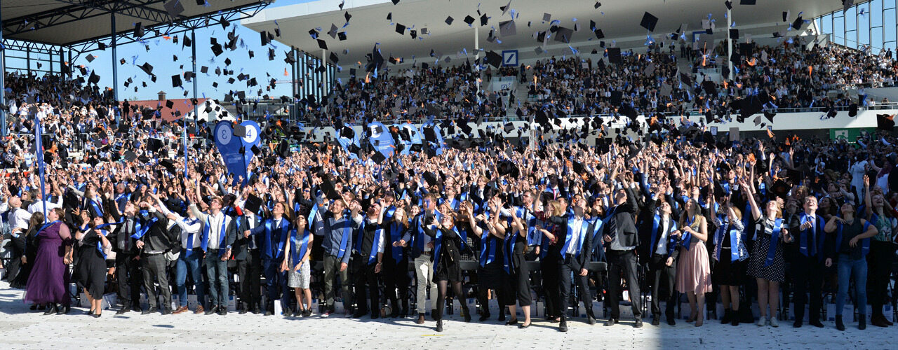 Students throwing their caps in the air